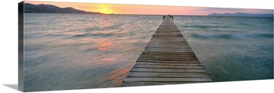 Pier at sunset in the sea, Alcudia, Majorca, Spain