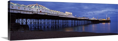 Pier lit up at dusk Brighton Pier Brighton East Sussex England