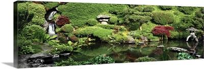 Pond in a formal garden, Japanese Tea Garden, Kozan-Ji, Yamagata, Japan