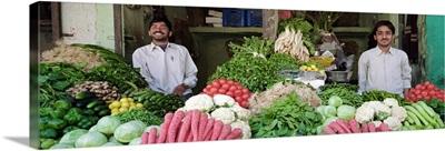 Portrait of two grocers smiling, Nagaur, Rajasthan, India