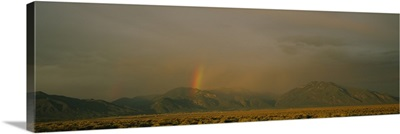 Rainbow in a cloudy sky, Taos, New Mexico