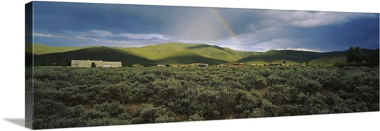 Rainbow over a rolling landscape, Taos, New Mexico