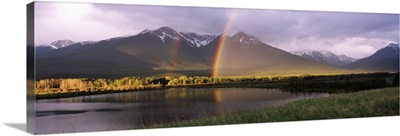 Rainbow over mountain range, Alberta, Canada