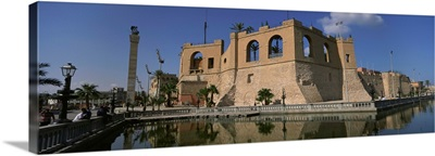 Reflection of a building in a pond, Assai Al Hamra, Tripoli, Libya