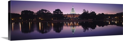 Reflection of a government building in a lake, Capitol Building, Washington DC