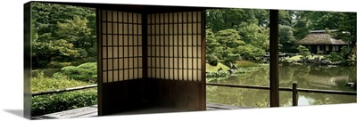Reflection of a house and trees on water, Katsura Imperial Villa, Kyoto, Japan
