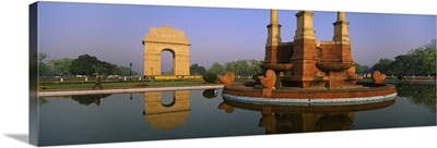 Reflection of a monument in water, India Gate, New Delhi, India