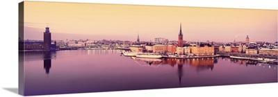 Reflection of buildings in a lake, Lake Malaren, Riddarholmen, Gamla Stan, Stockholm, Sweden