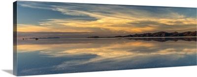 Reflection of clouds in a lake at sunset, Salar de Uyuni, Altiplano, Bolivia
