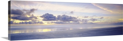 Reflection of clouds on water, Foxton Beach, North Island, New Zealand