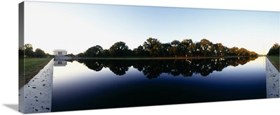 Reflection of monuments in a pond, Lincoln Memorial, Washington Monument, Washington DC