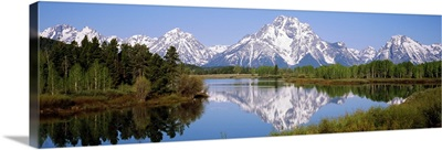 Reflection of mountains and trees in a river, Oxbow Bend, Snake River, Grand Teton National Park, Wyoming,