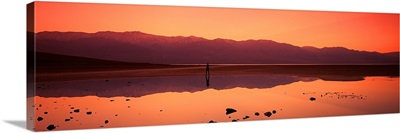 Reflection of mountains in water, Badwater, Death Valley, California,