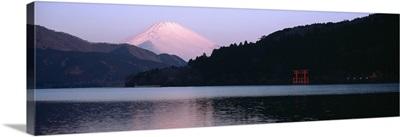 Reflection of snowcapped mountains in a lake, Lake Ashinoko, Mt Fuji, Hakone, Kanagawa Prefecture, Japan