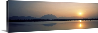 Reflection of sun in a lake, Western Ghats Hills, Tamil Nadu, India