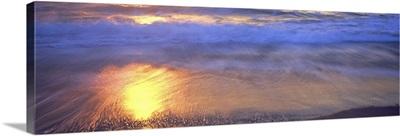 Reflection of sun in water on the beach, La Jolla, California