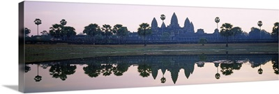 Reflection of temples and palm trees in a lake, Angkor Wat, Cambodia