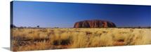 Rock formations on a landscape, Ayers Rock, Uluru-Kata Tjuta National Park, Northern Territory, Australia