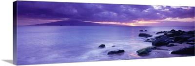 Rocks on coast at sunset, Maui, Hawaii