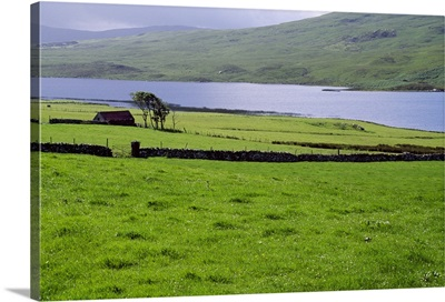Rural countryside with lake, Ireland.