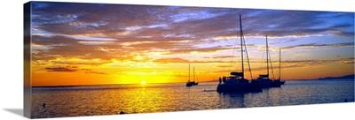 Sailboats in the ocean at sunset, Tahiti, Society Islands, French Polynesia