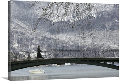 Side profile of a person walking on a bridge, Lake Annecy, French Alps, France
