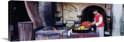 Side profile of a young man preparing sweet food, Mandawa, Rajasthan, India