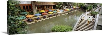 Sidewalk cafes along a river, San Antonio River Walk, San Antonio River, San Antonio, Bexar County, Texas