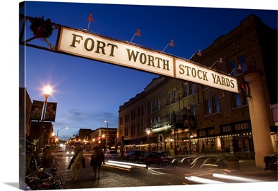 Signboard over a road at dusk, Fort Worth Stockyards, Fort Worth, Texas
