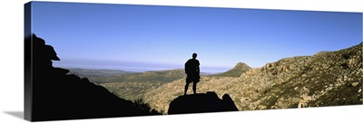 Silhouette of a hiker standing on a rock, Cederberg Mountains, South Africa