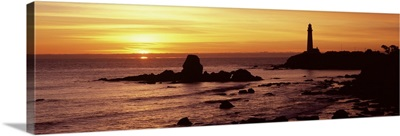 Silhouette of a lighthouse at sunset, Pigeon Point Lighthouse, San Mateo County, California,