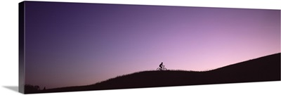 Silhouette of a person mountain biking, Waits River, Vermont