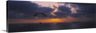 Silhouette of a person paragliding over the sea, Blacks Beach, San Diego, California
