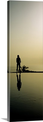 Silhouette of a woman standing at the poolside, Infinity Pool, Movenpick Resort, Jordan