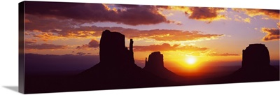 Silhouette of buttes at sunset, Monument Valley, Utah