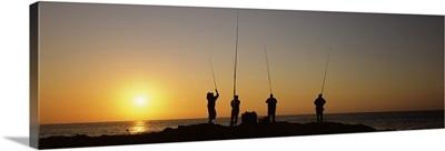 Silhouette of fishermen fishing in river at sunset Scottburgh KwaZulu Natal South Africa