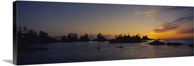 Silhouette of kayaks in the sea, Clayoquot Sound, Vancouver Island, British Columbia, Canada