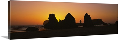 Silhouette of rock formations at sunset, Pacific Ocean, Bandon State Natural Area, Bandon, Oregon