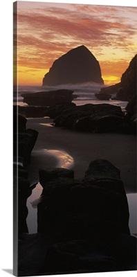Silhouette of rock formations on the beach, Haystack Rock, Cape Kiwanda State Park, Pacific City, Oregon