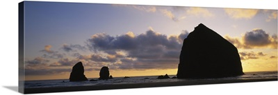 Silhouette of rocks at sunset, Cannon Beach, Oregon