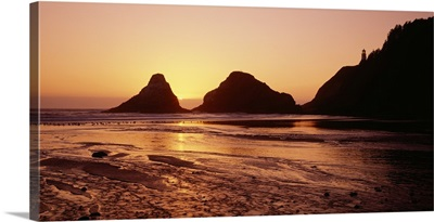 Silhouette of rocks at sunset, Heceta Head Lighthouse, Devils Elbow State Park, Oregon