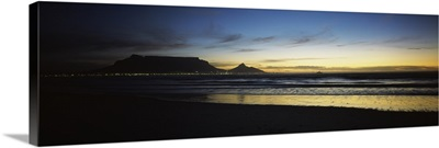 Silhouette of Table Mountain at sunset, Table Bay, Bloubergstrand, Cape Winelands, Western Cape Province, South Africa