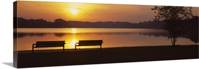 Silhouette of two benches along a lake, Reeds Lake, Grand Rapids, Michigan
