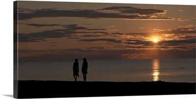 Silhouette of two people on the beach at sunset, Jetties Beach, Nantucket, Massachusetts