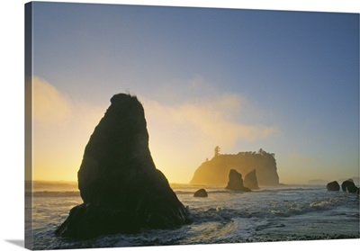 Silhouetted Sea Stacks In Pacific Ocean