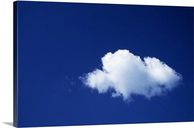 Single white cloud, blue sky.