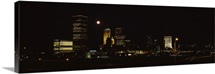 Skyscrapers in a city lit up at night Tulsa Oklahoma