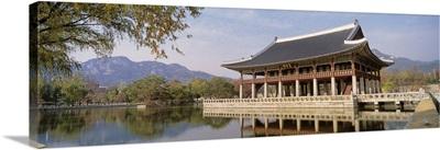 South Korea, Seoul, Kyongheru, View of traditional architecture on a lake