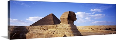 Sphinx in front of a pyramid, Great Pyramid, Giza, Cairo, Egypt