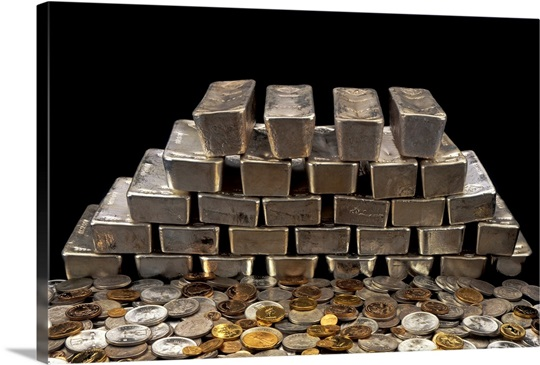 Stack of sliver ingots and pile of coins